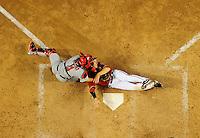 Apr. 14, 2009; Phoenix, AZ, USA; Arizona Diamondbacks base runner Stephen Drew is tagged out by St. Louis Cardinals catcher Yadier Molina in the ninth inning at Chase Field. Mandatory Credit: Mark J. Rebilas-