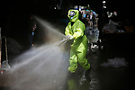 Palestinian municipal workers spray disinfectant as a precaution against the spread of the COVID-19 coronavirus at a market in Gaza City, on March 27, 2020. Photo by Osama Baba