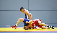 11 MAY 2014 - SHEFFIELD, GBR - Charlie Bowling (top) attempts to overpower Nathan Ferguson (bottom) during their men's 65kg category freestyle match at the British 2014 Senior Wrestling Championships in EIS in Sheffield, Great Britain (PHOTO COPYRIGHT © 2014 NIGEL FARROW, ALL RIGHTS RESERVED)