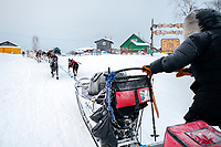 John Baker runs up the Yukon riverbank as he gets into the Kaltag checkpoint during the 2017 Iditarod on Sunday morning March 12, 2017.<br /> <br /> Photo by Jeff Schultz/SchultzPhoto.com  (C) 2017  ALL RIGHTS RESERVED