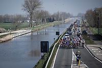 Peloton races along the canal. <br /> <br /> Bredene Koksijde Classic (2019) ( former Handzame Classic )<br /> Bredene > Koksijde 199km (BEL)<br /> <br /> ©kramon