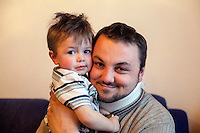 Former refugee Elvis Causevic with his son Aldin in the family home. <br /> <br /> In 1992 while volunteering at the Varazdin refugee camp Panos photographer Bjoern Steinz met and became close to Elvis, a Bosnian Muslim refugee, and his family. They shared the hardships of camp life together which Steinz documented. While the prints were archived for many years two of the images always returned to Bjoern's thoughts. 25 years later he set out to try and find out what had happened to Elvis and his family in the intervening years. Modern social media made the task surprisingly easy and they were reunited in Hadzici where Elvis now lives with his family.