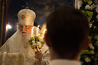Switzerland. Geneva. Easter at the Russian Church. The church is a lovely 19th-century Russian Orthodox church and designed in a Byzantine Moscovite style. The church's full name is Cathédrale de l'Exaltation de la Sainte Croix. The Archbishop Michael during the religious service on the night of Easter Sunday. The nighttime liturgy is a blessing of Easter fire with candles and the celebration of the Easter Proclamation of the Resurrection of Jesus Christ. He holds in his left hand the Paschal Trikirion which is a liturgical triple-candlestick used at Easter time in the Eastern Orthodox ceremony. It is used from the commencement of the celebration of the Resurrection during the Paschal Vigil. Archbishop Michael (Secular name - Simeon Vasilyevich Donskoff; born on 29 March 1943) is a bishop of the Russian Orthodox Church Outside of Russia, Archbishop of Geneva and Western Europe. Easter, also called Pascha or Resurrection Sunday is a festival and holiday celebrating the resurrection of Jesus from the dead, described in the New Testament as having occurred on the third day of his burial after his crucifixion.The Russian church serves not only the Russian community but also Bulgarians, Serbs, Coptic Christians and other Orthodox worshippers who do not have their own church in Geneva. 16.04.17 © 2017 Didier Ruef