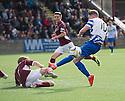 Stenny's Kieran Millar blocks Morton's Declan McManus's shot .