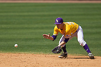 LSU Tigers shortstop Alex Bregman #30 fields a ground ball against the Auburn Tigers in the NCAA baseball game on March 24, 2013 at Alex Box Stadium in Baton Rouge, Louisiana. LSU defeated Auburn 5-1. (Andrew Woolley/Four Seam Images).