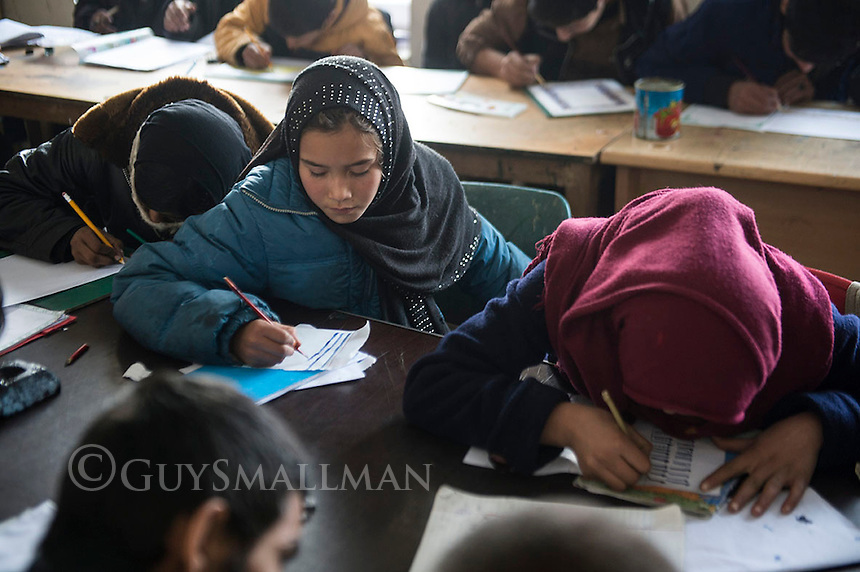 Ascianna Centre Kabul 14-1-14 Vocational training at the Headquarters of the Ascianna NGO in Kabul. The Eurpean Commission recenly withdraw their funding for Ascianna which had to close most of its projects around the country reducing its staff from 150 to 35. Their work is geared towards helping poor, refugee and underpriviledged Afghan children. Art workshop.