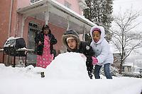 Kids make a snowman in Charlottesville, Va.