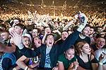 © Joel Goodman - 07973 332324 . No Editorial syndictaion permitted . 09/09/2017. Manchester , UK . Crowd at the front of the stage . We Are Manchester reopening charity concert at the Manchester Arena with performances by Manchester artists including  Noel Gallagher , Courteeners , Blossoms and the poet Tony Walsh . The Arena has been closed since 22nd May 2017 , after Salman Abedi's terrorist attack at an Ariana Grande concert killed 22 and injured 250 . Money raised will go towards the victims of the bombing . Photo credit : Joel Goodman