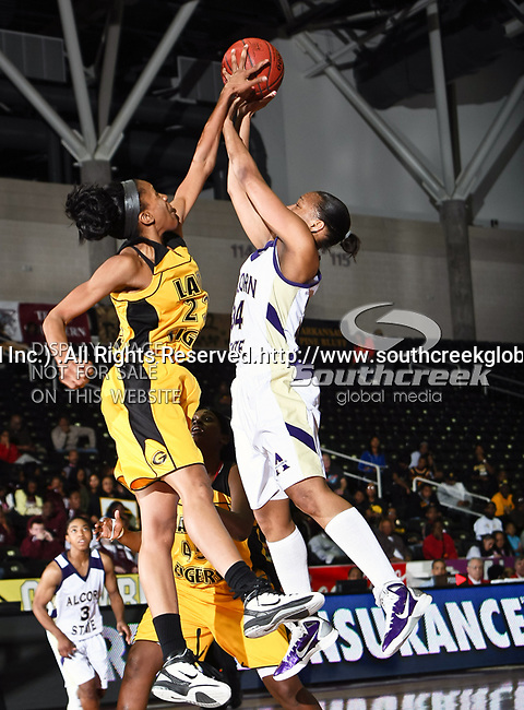 Grambling State Lady Tigers forward/center Secrett Anderson (23) and Alcorn State Lady Braves forward Sharnika Breedlove (34) in action during the SWAC Tournament game between the Alcorn State Braves and the Grambling State Tigers at the Special Events Center in Garland, Texas. Grambling State defeats Alcorn State 72 to 63.