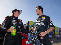 Apr 11, 2015; Las Vegas, NV, USA; NHRA pro stock driver Erica Enders-Stevens (left) is congratulated by Vincent Nobile after winning the K&N Horsepower Challenge during the Summitracing.com Nationals at The Strip at Las Vegas Motor Speedway. Mandatory Credit: Mark J. Rebilas-