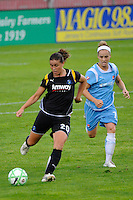 Camille Abily (20) of the Los Angeles Sol is marked by Kelly Parker (7) of Sky Blue FC. Sky Blue FC and the Los Angeles Sol played to a 0-0 tie during a Women's Professional Soccer match at Yurcak Field in Piscataway, NJ, on June 13, 2009.