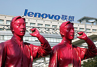 A Lenovo logo seen though a sculpture at the company's office in Shanghai, China. Lenovo, China's largest PC maker, has forecasted that  it will make a loss for the first time in three years as demand for computers decline, as a result then company will lay off 2500 workers, about ten percent of its workforce, from around the globe..