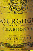 Closeup close-up of a wine bottle label Maison Louis Jadot Bourgogne Chardonnay Appellation Controlee backlit backlight back lit light white, Maison Louis Jadot, Beaune Côte Cote d Or Bourgogne Burgundy Burgundian France French Europe European