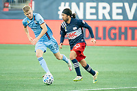 FOXBOROUGH, MA - SEPTEMBER 19: Lee Nguyen #42 of New England Revolution brings the ball forward with Keaton Parks #55 of New York City FC closing in to tackle during a game between New York City FC and New England Revolution at Gillette on September 19, 2020 in Foxborough, Massachusetts.
