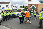 © Joel Goodman - 07973 332324 . 13/08/2011 . Shropshire , UK . The EDL security team eject a disruptive supporter from their demonstration space . Approximately 300 EDL supporters demonstrate against a paedophile ring in the small Telford town of Wellington . The group had planned to march, however the Home Secretary has imposed a ban on all marches in the area just days after riots have swept across England. A counter-demonstration has attracted about 300 people . Photo credit : Joel Goodman