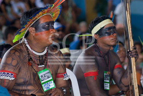 """Altamira, Brazil. """"Xingu Vivo Para Sempre"""" protest meeting about the proposed Belo Monte hydroeletric dam and other dams on the Xingu river and its tributaries. Yudja chief  Yapariwa listens to the presentation."""