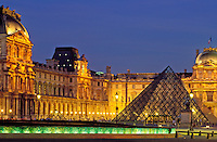 France, Paris, The Louvre with I M Pei's pyramid illuminated at night