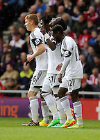 Pictured: Marvin Emnes of Swansea (3rd L) celebrating his goal with team mates L-R Jay Fulton, Wilfried Bony and co-scorer Nathan Dyer, making the score 2-0 to Swansea. Sunday 11 May 2014<br /> Re: Barclay's Premier League, Sunderland v Swansea City FC at the Stadium of Light, Sunderland, UK.