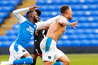 1st May 2021; Weston Homes Stadium, Peterborough, Cambridgeshire, England; English Football League One Football, Peterborough United versus Lincoln City; Jonson Clarke-Harris and Mohamed Eisa of Peterborough United celebrate Clarke-Harris' equalising goal after 95 minutes, guaranteeing promotion to the EFL Championship