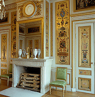 Prince Frederik Adolf's bedroom features walls with colourful arabesques on a gold background by Anders Hultgren and a medallion of the prince by Johan Sergel