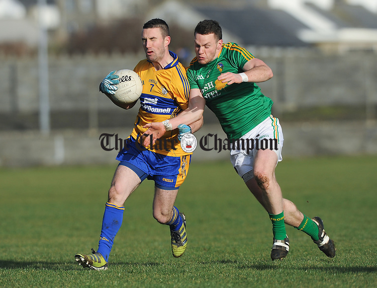 Shane Hickey of Clare in action against Gary Reynolds of Leitrim during their Round 2 Division 4 national Football League game at Miltown Malbay. Photograph by John Kelly.