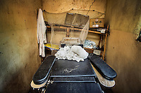 An operating table in a room, in the remote village of Pania, where Doctor Richard Hardi and his medical team will perform eye surgery. <br /> <br /> From his base in Mbuji Mayi Hungarian ophthalmologist Friar Richard Hardi and his team travelled deep into the Congolese rainforest, by 4x4 and canoe, to treat people in isolated communities most of whom have never seen an ophthalmologist. At a small village called Pania they established a temporary field hospital and over the next three days made hundreds of consultations. Although both conditions are preventable, many of the patients they saw had Glaucoma or River Blindness (onchocerciasis) that had permanently damaged their eyesight. However, patients with cataracts, a clouding of the eye's lens, who were suitable for treatment were booked for an operation. For two days the team carried out the ten minute procedure on one patient after another. The surgery involves making a 2.2mm incision into the remove the damaged lens that is then replaced by an artificial one. Doctor Hardi is one of the few people willing to make such a journey but is inspired to do so by his faith and, as he says: 'Here I feel that I can really make a difference in people's lives'. /Felix Features