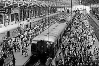 INDIA Mumbai Bombay , commuter ariving with trains of western railways at Churchgate station, 3 lines transport daily 6 billion people between suburbans and centre of the Megacity , copyright (c) Joerg Boethling
