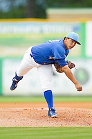 Burlington Royals starting pitcher Andres Machado (36) follows through on his delivery against the Greeneville Astros at Burlington Athletic Park on July 1, 2013 in Burlington, North Carolina.  The Astros defeated the Royals 8-1 in Game Two of a doubleheader.  (Brian Westerholt/Four Seam Images)