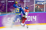 (L) Loui Eriksson of Sweden being followed by (R) Zbynek Michalek of Czech Republic during the match between Sweden vs Czech Republic during their Men's Ice Hockey Preliminary Round Group C game on day five of the 2014 Sochi Olympic Winter Games at Bolshoy Ice Dome on February 12, 2014 in Sochi, Russia. Photo by Victor Fraile / Power Sport Images