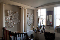 A pair of floral plaster reliefs adorn the walls of the stairwell