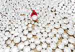 Thousands of shiny silver pots are left to dry in the hot afternoon sun.   As many as 5,000 pots a day are cleaned with chemicals which make them shine before being rinsed with water, then dried in the sunlight for around half an hour.  <br /> <br /> The pots - generally used to make food - take around three minutes to make at a nearby silver factory.   The photos were taken by hobby photographer Touhid Parvez, in the city of Bogura in Bangladesh.  SEE OUR COPY FOR DETAILS.<br /> <br /> Please byline: Touhid Parvez Biplob/Solent News<br /> <br /> © Touhid Parvez Biplob/Solent News & Photo Agency<br /> UK +44 (0) 2380 458800