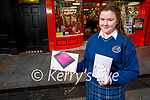 Marissa Hanley from Causeway Comprehensive School, winner of the Kerry Education and Training Board's annual Christmas Card Competition, receiving her prize of a Tablet at Hugh Cullotys on Wednesday.