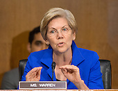 """United States Senator Elizabeth Warren (Democrat of Massachusetts), a member of the U.S. Senate Committee on Banking, Housing and Urban Affairs, listens to testimony from Janet L. Yellen, Chair, Board of Governors of the Federal Reserve System (not pictured), on """"The Semiannual Monetary Policy Report to the Congress."""" on Capitol Hill in Washington, D.C. on Tuesday, July 15, 2014.<br /> Credit: Ron Sachs / CNP"""