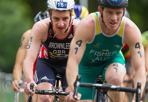 31 MAY 2014 - LONDON, GBR - Alistair Brownlee (GBR) (ENG (left) of Great Britain and England drafts Ryan Fisher (AUS) of Australia on the bike during the men's 2014 ITU World Triathlon Series round in Hyde Park, London, Great Britain (PHOTO COPYRIGHT © 2014 NIGEL FARROW, ALL RIGHTS RESERVED)