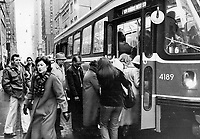 Rush-hour crush: The struggle to get on a streetcar at Bay and King Sts. during the rush hour. Some streetcars that are supposed to carry 80 to 90 people are squeezing in 130 during peak periods. The subway and buses are also full to overflowing at certain times of the day and TTC officials expect the boom to continue; with more than 400 million riders in 1982 and possibly half a billion five years from now.