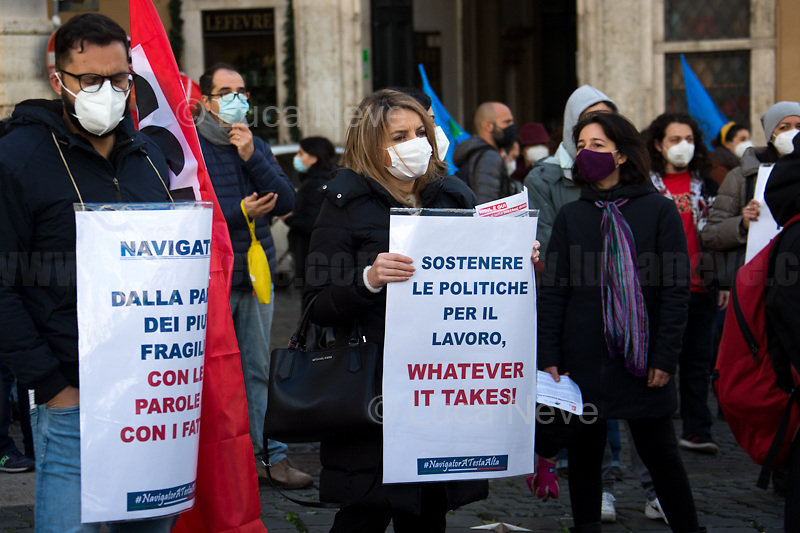 "Rome, Italy. 09th Feb, 2021. Today, the tree Italian main Trade Unions, CGIL, CISL and UIL, held a national demonstration (1.) outside the Italian Parliament in Piazza Montecitorio to highlights the situation of the employment centers' ""Navigators"" and their national contract which will expire at the end of April 2021. From the organisers Facebook event page: «The employment contracts of the 2,700 navigators who have been operating for over a year in employment centers throughout Italy and more generally in the field of active employment policies will expire on 30 April. Failure to renew them would have serious repercussions both in terms of employment and services provided to the community. After numerous attempts at discussions with Institutions that have remained unanswered to date, Nidil Cgil, Felsa Cisl and Uiltemp, we have promoted the first national mobilization day for the navigator dispute […]».<br />