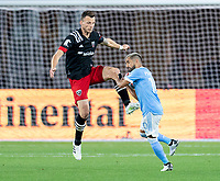 WASHINGTON, DC - APRIL 17: Frederic Brillant #13 of D.C. United clears the ball away from Maxi Moralez #10 of New York City FC during a game between New York City FC and D.C. United at Audi Field on April 17, 2021 in Washington, DC.
