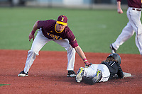 Luke Bowerbank (29) of the Rutgers Scarlet Knights is tagged out by Brian Picone (15) of the Iona Gaels as he tries to steal second base at City Park on March 8, 2017 in New Rochelle, New York.  The Scarlet Knights defeated the Gaels 12-3.  (Brian Westerholt/Four Seam Images)