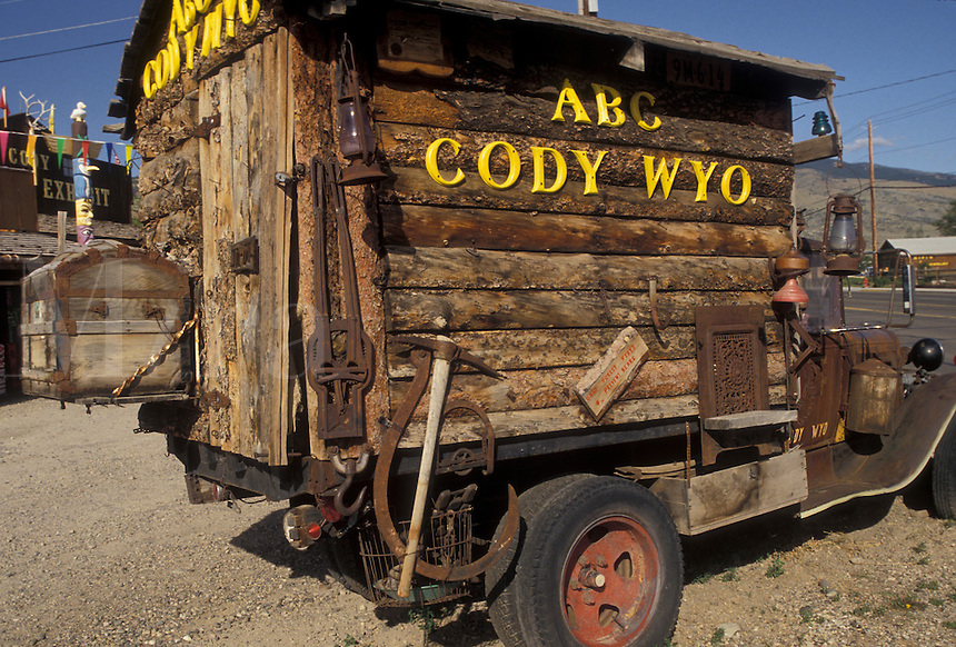 AJ3559, Cody, Wyoming, An old pick up truck with a wooden sided house on its flatbed is parked in front of an old trading post in Cody in the state of Wyoming.