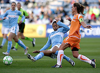 Chicago Red Star forward Cristiane (11) slides to stop a clearance by Sky Blue FC defender Christie Rampone (3).  The Sky Blue FC defeated the Chicago Red Stars 2-0 at Toyota Park in Bridgeview, IL on May 10, 2009.
