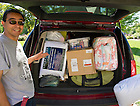 Aug. 23, 2013; A parent of an incoming first year student points to the carload of dorm room supplies to be moved in on move-in day 2013.<br /> <br /> Photo by Matt Cashore/University of Notre Dame