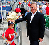 8 June 2010: Washington Nationals fan and future star Jake Feffer has words with agent Scott Boras prior to a game against the Pittsburgh Pirates at Nationals Park in Washington, DC. The Nationals defeated the Pirates 5-2 in the series opener where pitching sensation Stephen Strasburg made his Major League debut, striking out 14 batters and notching his first win in the majors. Mandatory Credit: Ed Wolfstein Photo