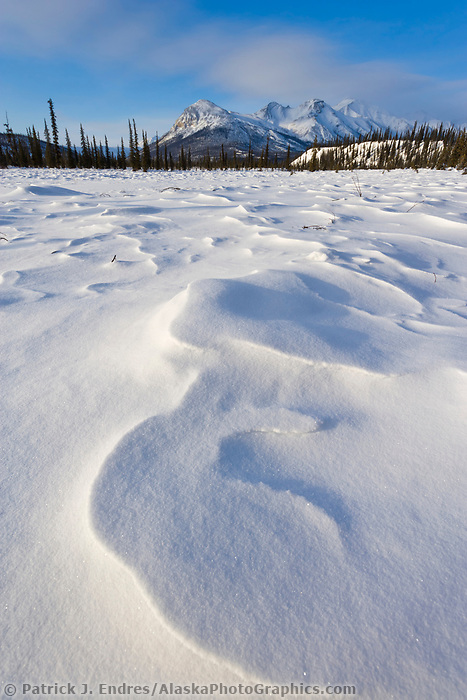Wind blown snow patterns and wiehl mountain in the Brooks Range, Arctic, Alaska.