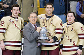 Paul Carey (BC - 22), Tommy Cross (BC - 4) and Barry Almeida (BC - 9) pose with Steve Nazro and the Beanpot. - The Boston College Eagles defeated the Boston University Terriers 3-2 (OT) to win the 2012 Beanpot championship on Monday, February 13, 2012, at TD Garden in Boston, Massachusetts.