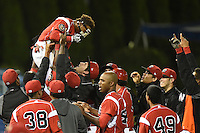 Batavia Muckdogs second baseman Mason Davis (7) is lifted in the air by pitcher Josh Hodges (44) after hitting a walk off home run during the second game of a doubleheader against the Williamsport Crosscutters on July 29, 2014 at Dwyer Stadium in Batavia, New York.  Batavia defeated Williamsport 1-0.  (Mike Janes/Four Seam Images)