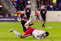Rafa Marquez (4) of the New York Red Bulls and Chris Pontius (13) of D. C. United fall to the ground after Marquez fouls Pontius on a header. D. C. United defeated the New York Red Bulls 1-0 (2-1 in aggregate) during the second leg of the MLS Eastern Conference Semifinals at Red Bull Arena in Harrison, NJ, on November 8, 2012.