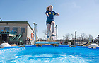 March 21, 2021; Freshman Kaleyna Zahuranic takes the polar plunge at Four Winds Field at Coveleski Stadium.  Each year, Special Olympics puts on a Polar Plunge event. Due to COVID-19, the plunge was pushed back this year and held at Four Winds field home of the South Bend Cubs. The plunge is a huge fundraiser for Special Olympics Indiana.  (Photo by Barbara Johnston/University of Notre Dame)