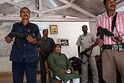 Armed guards pose with Mahendra Karma (centre), the founder of Salwa Judum in Dantewara in Chhattisgarh, India. Photo: Sanjit Das/Panos