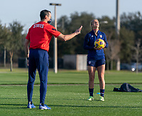 ORLANDO, FL - JANUARY 21: Vlatko Andonovski of the USWNT talks to Lindsey Horan #9 during a training session at the practice fields on January 21, 2021 in Orlando, Florida.