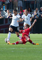 02 June 2013: U.S. Women's National Team defender Ali Krieger #11 and Canadian Women's National player Sophie Schmidt #13 in action during an International Friendly soccer match between the U.S. Women's National Soccer Team and the Canadian Women's National Soccer Team at BMO Field in Toronto, Ontario.<br /> The U.S. Women's National Team Won 3-0.